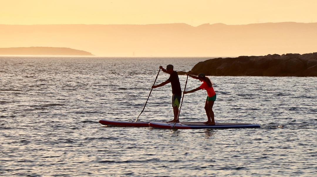 technique de rame stand up paddle sunset